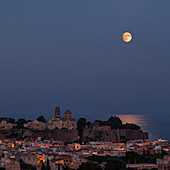 Full moon over the city of Lipari in the Aeolian Islands at night, Sicily Italy