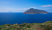 Lipari coastline with view of Salina volcanic island at day, Sicily Italy
