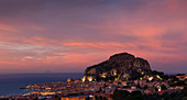 City of Cefalu with Rocca di Cefalù at sunset, Sicily Italy