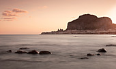 City of Cefalu with Rocca di Cefalù at sunrise and sea, Sicily Italy