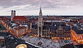 Frauenkirche, town hall, Marienplatz and Kaufingerstrasse of the city of Munich from above in the evening