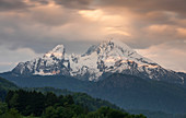 Snowy peaks of the Watzmann in Berchtesgaden with clouds at sunrise, Bavaria