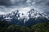 Snow-covered summit of the Watzmann in Berchtesgaden with dramatic clouds, Bavaria