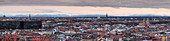 Panoramic skyline of Munich city with snowy Alps in the background at sunset