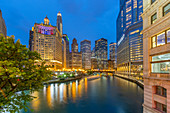 View of Chicago River and buildings illuminated at dusk, Chicago, Illinois, United States of America, North America