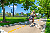 View of Chicago skyline and cyclist on South Lake Shore Drive, Chicago, Illinois, United States of America, North America