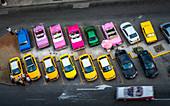 Aerial view of colourful old American taxi cars parked in Havana at dusk, La Habana, Cuba, West Indies, Caribbean, Central America