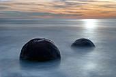 Two Moeraki Boulders at sunrise with long exposure, Moeraki Beach, Otago, South Island, New Zealand, Pacific