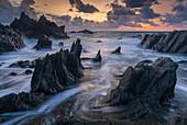 Sunset over the dramatic coast of North Devon, England, United Kingdom, Europe