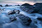 Waves and wet rock ledges at Hartland Quay in North Devon at sunset, Devon, England, United Kingdom, Europe