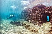 Scuba diver swimming through submerged ancient Roman building ruins, Dragonara caves, Miseno, Campi Flegrei (Phlegraean Fields), Campania, Italy, Mediterranean, Europe