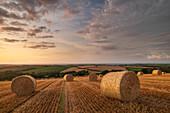 Straw bales at sunset in rural Devon, Livaton, Devon, England, United Kingdom, Europe