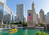 View of The Wrigley Building, Chicago River and watertaxi from DuSable Bridge, Chicago, Illinois, United States of America, North America