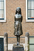 Statue of Anne Frank outside Westerkerk Church, Amsterdam, North Holland, The Netherlands, Europe