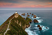 Nugget Point lighthouse at sunset, Kaka Point, Otago, South Island, New Zealand, Pacific