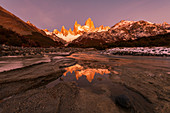 Mountain range with Cerro Torre and Fitz Roy at sunrise reflected, Los Glaciares National Park, UNESCO World Heritage Site, El Chalten, Patagonia, Argentina, South America