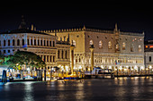 Night view of illuminated Palazzo Ducale (Doges Palace) facade with columns at St. Marks Square, seen from Dorsoduro, Venice, UNESCO World Heritage Site, Veneto, Italy, Europe