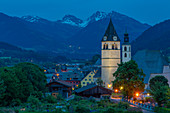 View of Liebfrauenkirche and town and surounding mountains at dusk, Kitzbuhel, Austrian Tyrol, Austria, Europe