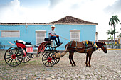 Cowboy waiting for riders with his horse and carriage in Plaza Mayor, Trinidad, UNESCO World Heritage Site, Cuba, West Indies, Caribbean, Central America