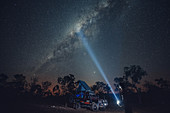 Landrover Defender SUV stands in the outback under a starry sky with the Milky Way, Darwin, Northern Territory, Australia, Oceania