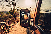 Rear-view mirror in off-road vehicle on four-wheel drive in El Questro Wilderness Park, Kimberley Region, Western Australia, Australia, Oceania;