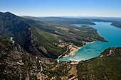 France, France, Var on the Left Bank and Alpes de Haute Provence on the Right Bank, Parc Naturel Regional du Verdon, Lake St. Croix at the exit of the Verdon Gorge (aerial view)