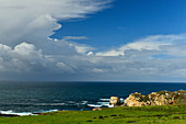 Rain clouds over the vastness of the Pacific coast at Carmel Highlands, California, USA
