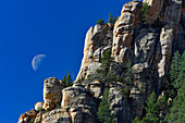 View of the moon and deep blue sky in the rocks of Red Rock State Park, Sedona, Arizona, USA