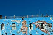 Elaborate, blue facade painting against a blue sky at venice Beach, California, USA