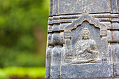Close up of a carving of Buddha on a statue at an Buddhist Temple, Okayama, Japan.