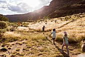 children hiking at sunset,Pilar, NM.