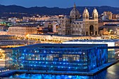 France, Bouches du Rhone, Marseille, Euromediterranee area, MuCEM, Museum of Civilization in Europe and the Mediterranean, R. and R. Carta Ricciotti architects, lighting Yann Kersale, The Cathedral Major (nineteenth century) historical monument in the background