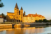 France, Saone et Loire, Paray le Monial, 12th century Sacred Heart basilica and the conventual buildings from the banks of Bourbince river