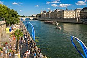 France, Paris, area listed as World Heritage by UNESCO, Paris Plage (Beach at Paris) 2015, Conciergerie at the back