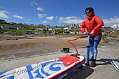 Stand-up paddle boarders in the village of Colliston Pier, Aberdeenshire
