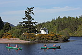 Kayaking on Loch Ness in front of Bona Lighthouse, the oldest lighthouse in Scotland, Lochend, Highlands