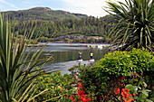 Stand-up paddle boarders at Loch Carron, Plockton, Highlands