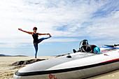 Standing yoga paddler on Luskentyre Beach, Isle of Harris, Outer Hebrides