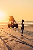 Sunset with SUVs at 80 Mile Beach in Western Australia, Australia, Indian Ocean, Oceania;