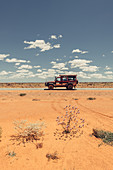 Off-road vehicle on a deserted road in the outback in Western Australia, Australia, Oceania;