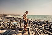 Man at the Hamelin Pool Marine Nature Reserve in Sharkbay in Western Australia, Australia, Oceania;