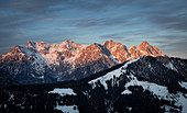 Mountains in sunset with Jakobskreuz in Fieberbrunn in the Wilder Kaiser at winter, Tyrol
