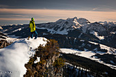Man at the Buchensteinwand in Fieberbrunn in the Wilder Kaiser at winter in the sunset, Tyrol