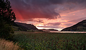 Rain clouds at sunset on Sihlsee near Euthal, Einsiedeln Switzerland