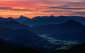 Mountain silhouettes with Jachenau am Walchensee at sunrise, from Jochberg, Bavarian Prealps