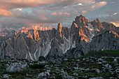 Mountain landscape with alpine glow in the Dolomites below the Lavardo hut at the Three Peaks in the sunset, South Tyrol