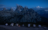 Parking space with motorhomes at Auronzo hut at night in the Three Peaks Nature Park in the Dolomites, South Tyrol