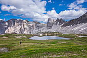 Man hiking on Lake Bödensee at the Drei Zinnen hut in the natural park of the Dolomites, South Tyrol