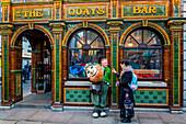 MAN DRESSED AS AN IRISH ELF IN FRONT OF THE PUB THE QUAYS BAR, DUBLIN, IRELAND