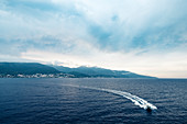 Pilot boat approaches the ferry off Bastia, Corsica, France